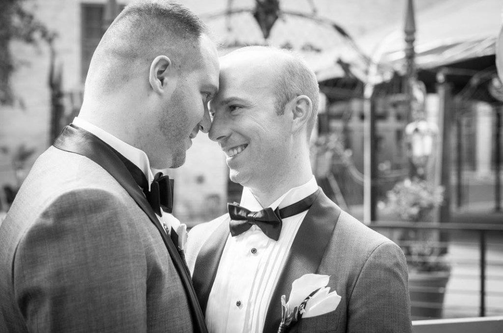 Timmie and Neil gazing into each other's eyes, black and white image