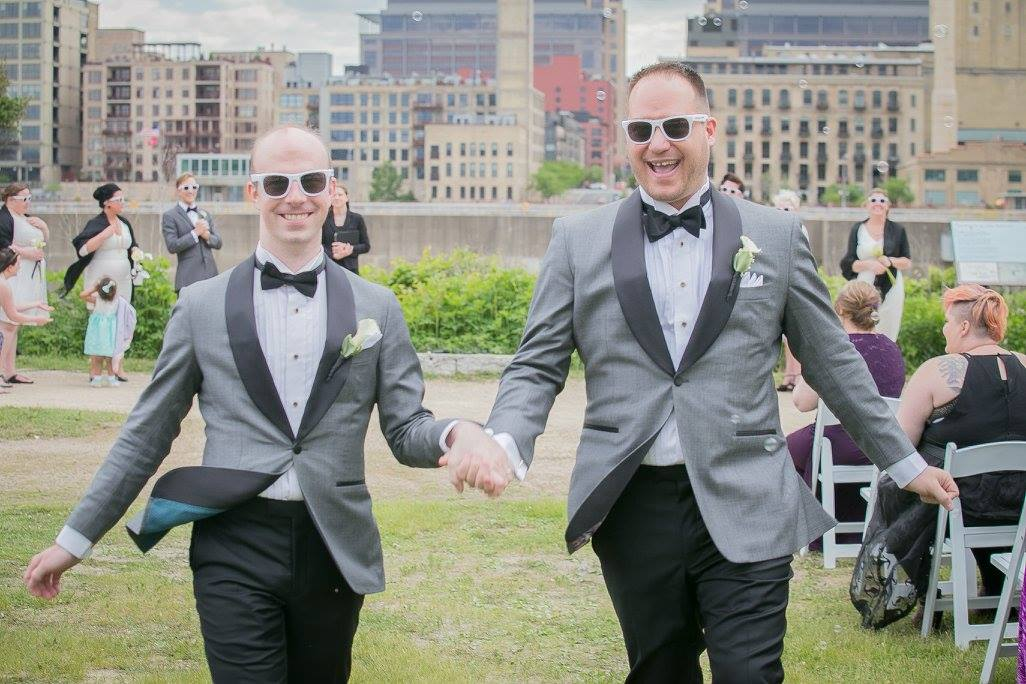 lgbtq couple skipping during wedding
