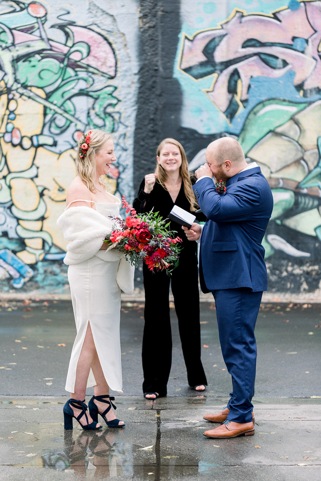 Wedding officiant and modern couple